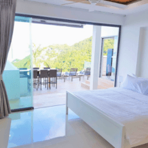 Bedroom 3. All 3 front bedrooms are the same size & offer sea views & a balcony.