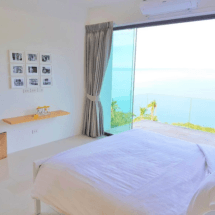 Bedroom 2. All 3 front bedrooms are the same size & offer sea views & a balcony.